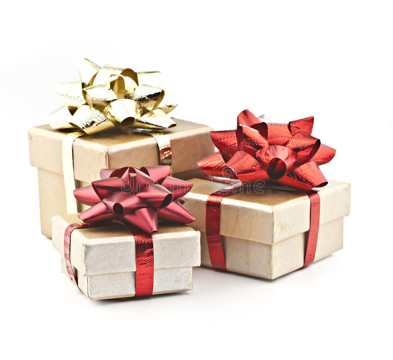 Gold gift boxs. On a white background golden gift box with red ribbon and gold braid royalty free stock photos