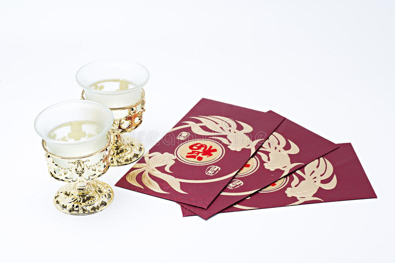Gold glass and packet for Chinese New Year stock photography