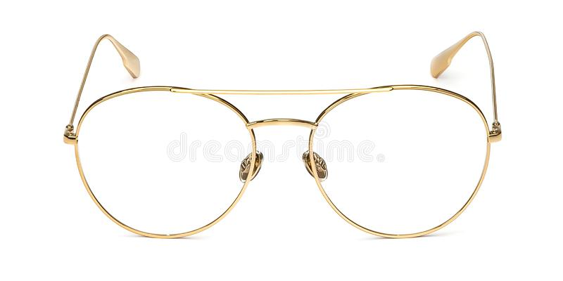 Gold glasses metal in round frame transparent for reading or good eye sight, front view isolated on white background royalty free stock photo