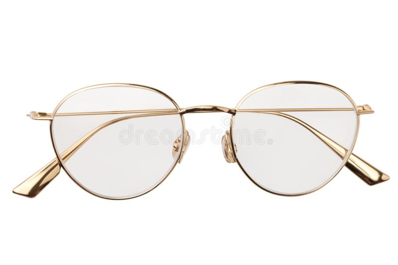 Gold glasses metal in round frame transparent for reading or good eye sight, top view isolated on white background royalty free stock photography