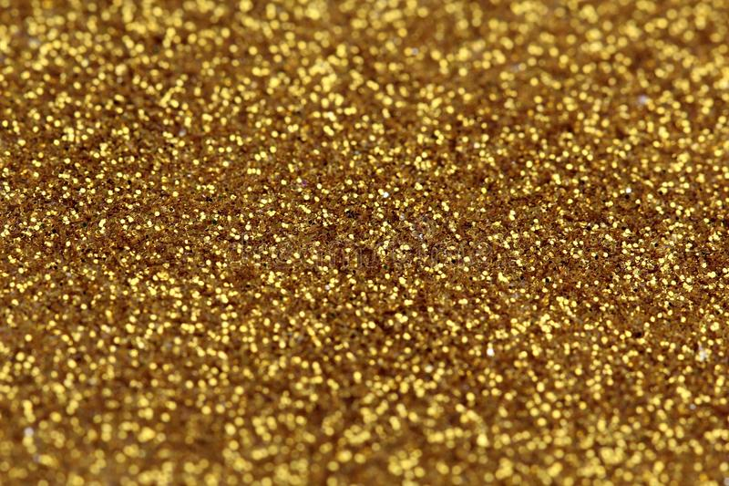 Gold glitter abstract background. With blurry edges