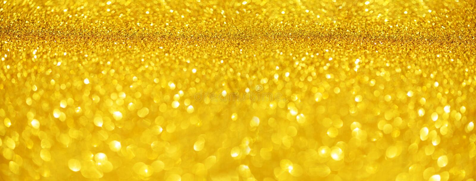 Gold glitter banner. Shiny abstract textured background with golden lights, bokeh. Christmas, new year concept with copy space for. Your greeting stock image