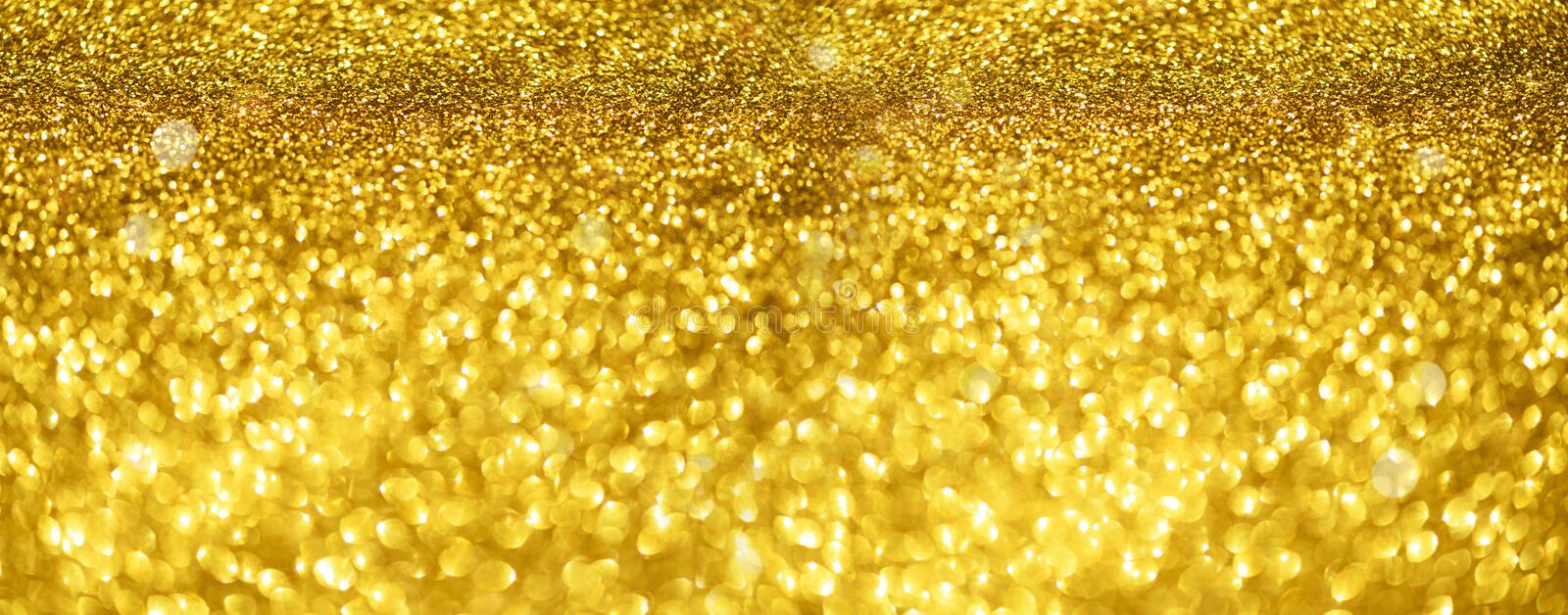 Gold glitter banner. Shiny abstract textured background with golden lights, bokeh. Christmas, new year concept with copy space for. Your greeting stock photography
