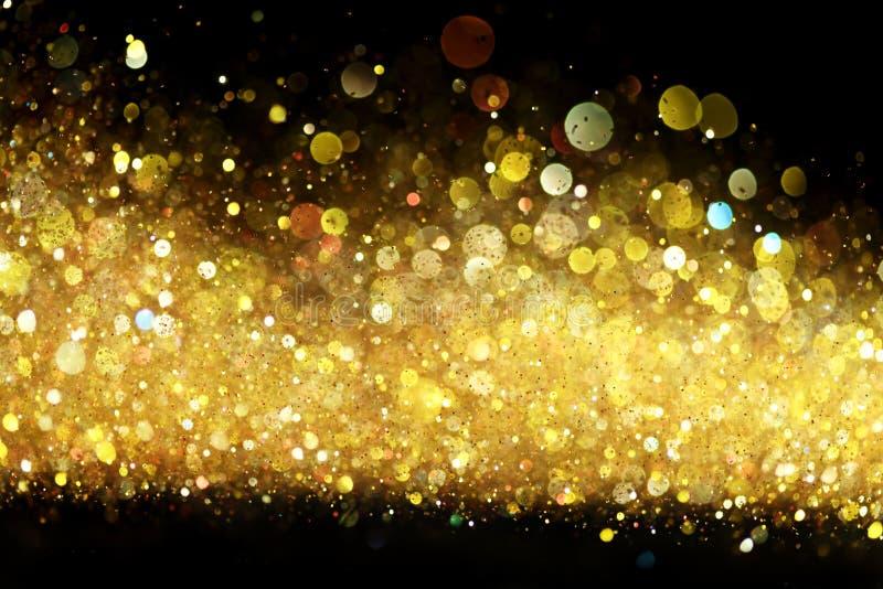 Gold glitter. On black background