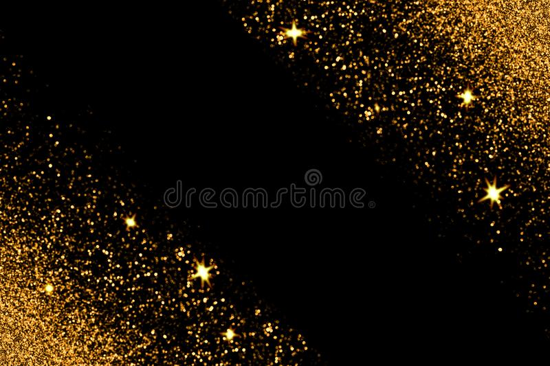 Gold glitter with glowing sparks on black background stock images