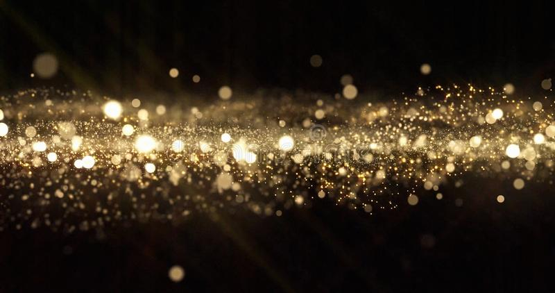 Gold glitter particles, light bokeh wave and golden shimmering sparkles overlay effect. Gold shimmer glow glittering sparkles. Shine, abstract magic snow bright stock photos