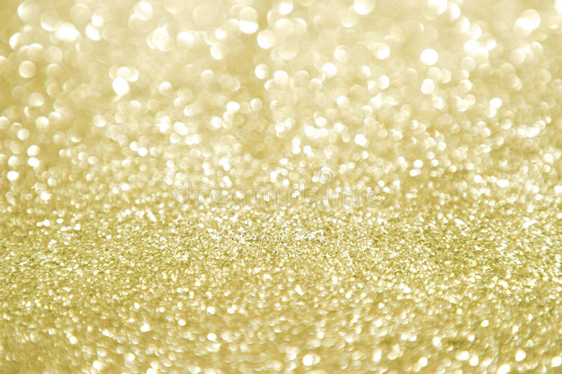 Gold glitter with selective focus. Semi defocused gold abstract background