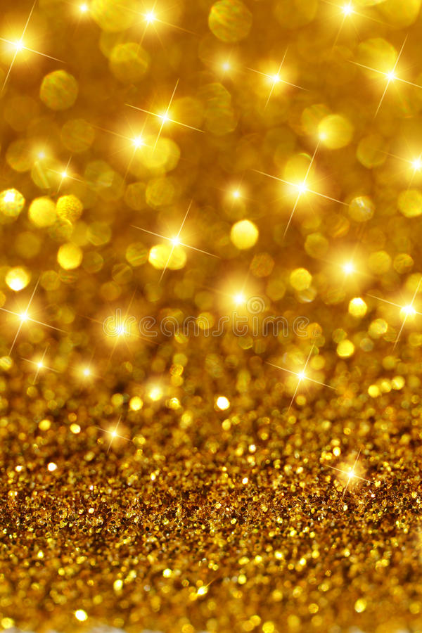 Gold Glitter and Stars. Macro closeup of gold glitter with stars and out of focus reflections
