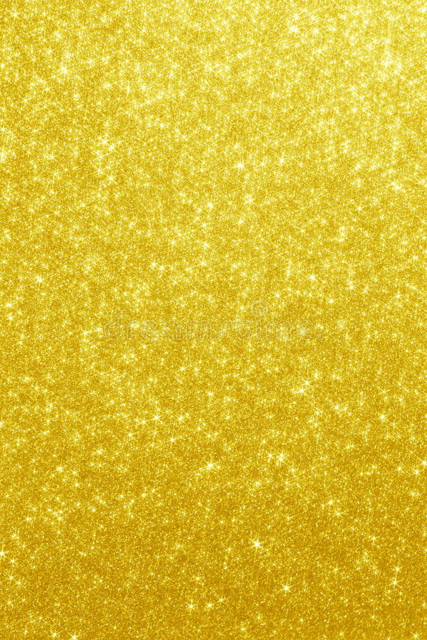 Gold Glitter Stars Background. Golden Backdrop with stars in blurred lights