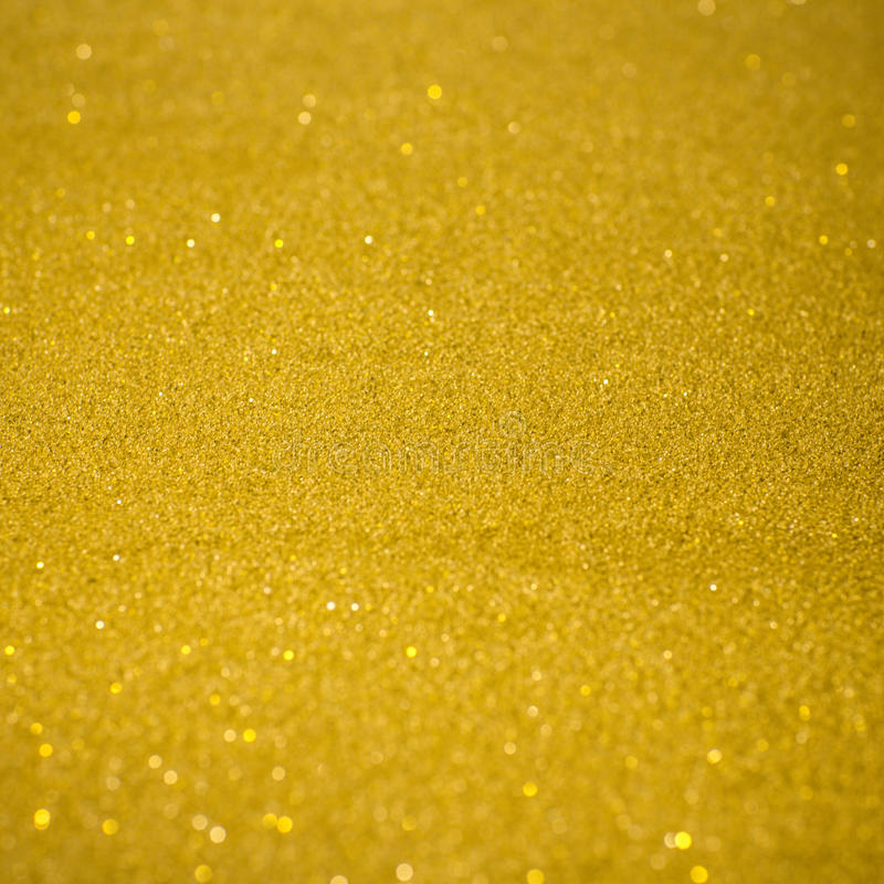 Gold glitter. Texture, abstract christmas lights on background royalty free stock photo