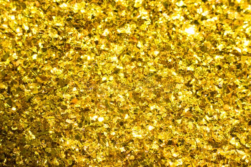 Gold glitter texture. Festive sparkling sequins background. Wpaper for Valentine, New Year or Christmas Holidays. Gold glitter texture. Festive sparkling stock image