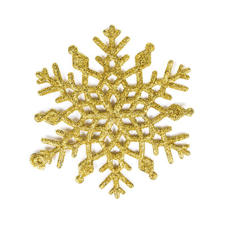Gold glitter texture snowflake isolated on white background.  stock photo