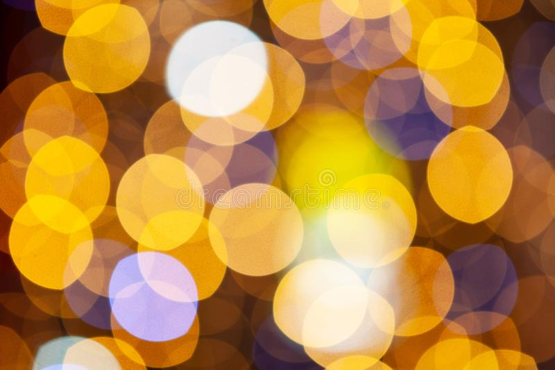 Gold glittering christmas lights. Blurred abstract background, close-up royalty free stock images