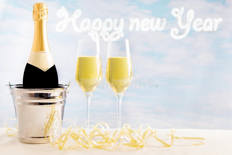 Champagne bottle and glasses in front of a blue background with the number 2019 and a firework in the background royalty free illustration