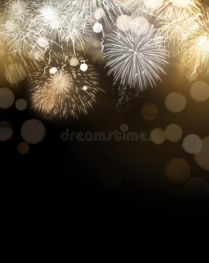 Gold Glittering Fireworks Display Background. Bright gold dazzling Fireworks display celebrations background with copy space royalty free stock photos
