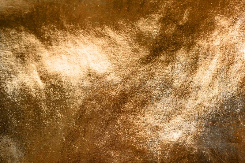 Background of uneven golden surface royalty free stock images