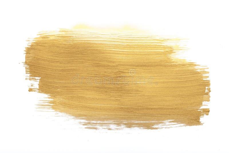Golden paint stroke isolated on white background stock image