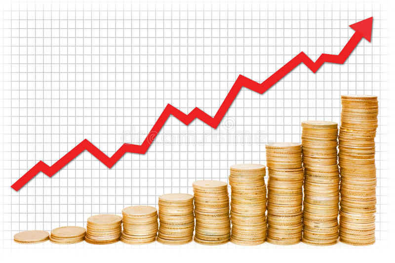 Gold Graph. A red graph on the rise over stacks of gold coins royalty free stock photos