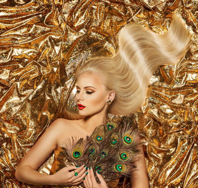 Gold Hair, Fashion Model Golden Waves Hairstyle, Blonde Girl on Sparkling Fabric royalty free stock image