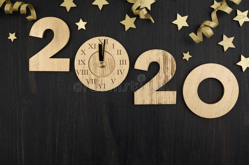 Gold 2020 Happy New Year and Merry Christmas greeting background. Top view stock photography