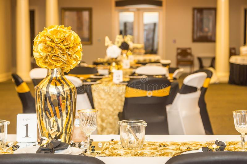 Gold Head Table Centerpiece at Black, White and Gold Themed Party royalty free stock photography