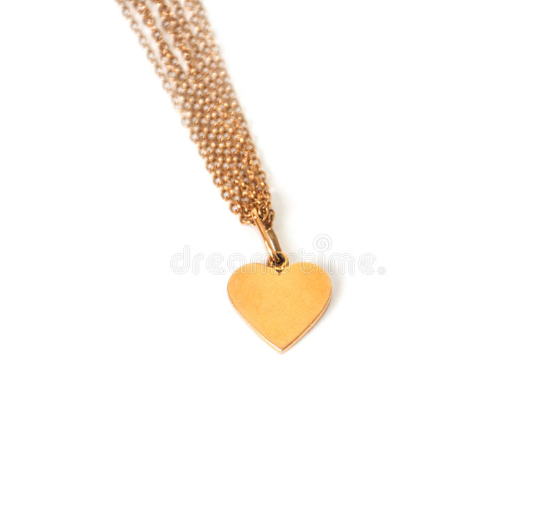 Gold heart on chain, isolated on white stock image