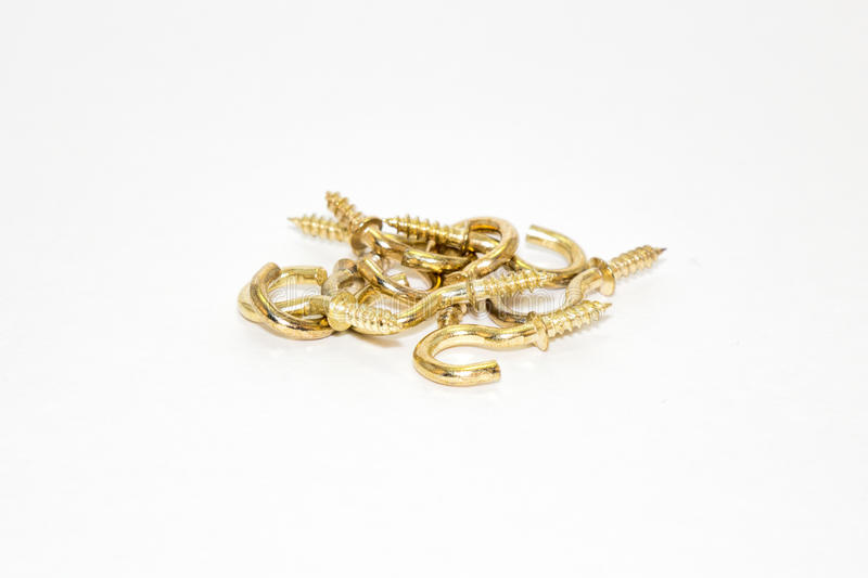 Gold hook. S-screw on white background royalty free stock image