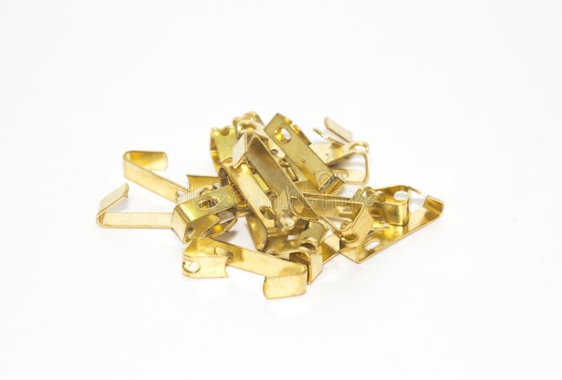 Gold hooks heap. On white background royalty free stock photo