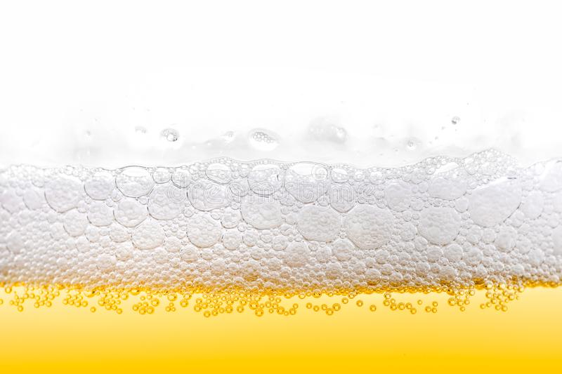 Gold Ice Cold Beer Foam With Bubbles Closeup stock image