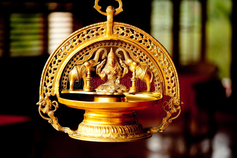 Gold indian goddess and two elephant sculpture. Gold goddess and two elephant at window background Kerala India stock image