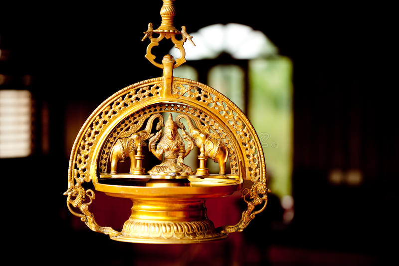 Gold indian goddess and two elephant sculpture. Gold goddess and two elephant at window background Kerala India royalty free stock images