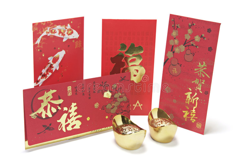 Gold Ingots And Red Packets Stock Photos