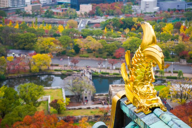 Gold Japanese fish statue on the top in Osaka Castle stock photography