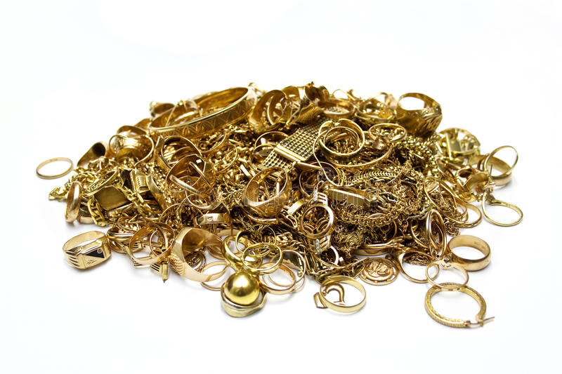 Gold jewelry. Pile of old gold jewelry isolated on white stock photo