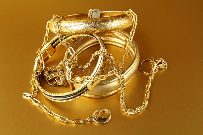 Gold jewelry, bracelets and chains stock photos