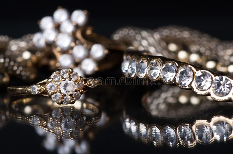 Gold jewelry with diamonds on blackboard. stock image