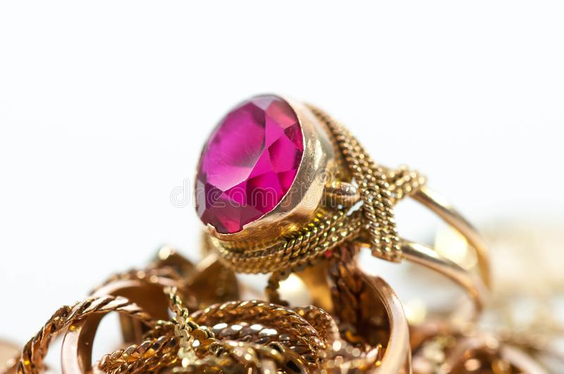 Gold jewelry with gems , chains close up royalty free stock photography