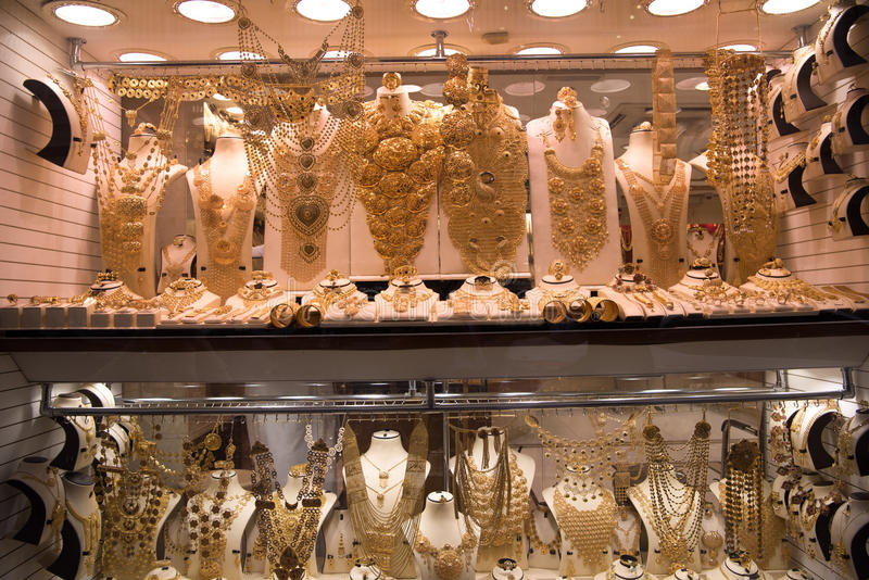 Gold jewelry in the shop window stock images