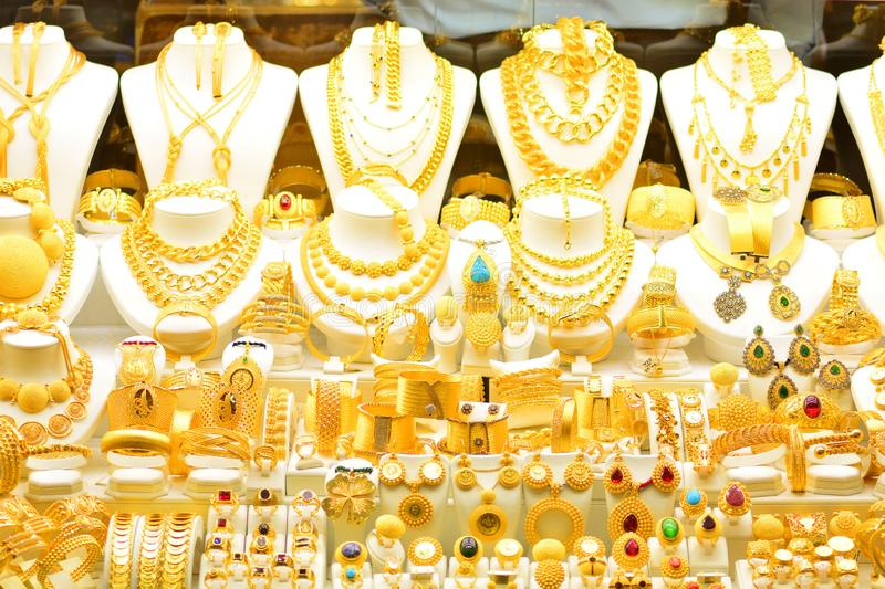 Gold jewelry in the window case of a jewelleries shop stock photos