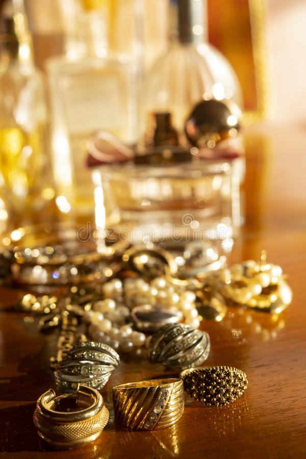 Gold jewels on a wooden plane royalty free stock photo