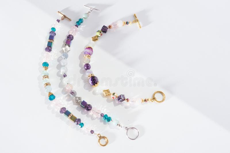 Gold jewerly braslete with semiprecious at white background royalty free stock images