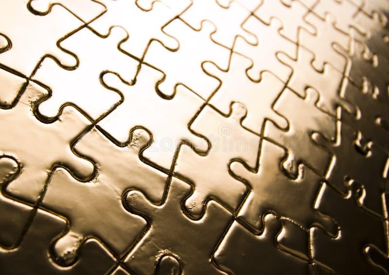 Gold jigsaws royalty free stock photos