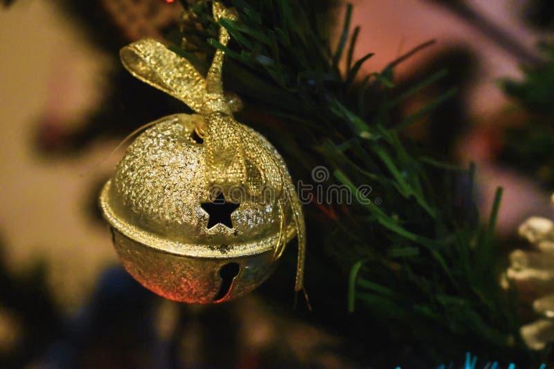 Gold jingle bell ornament. stock photos