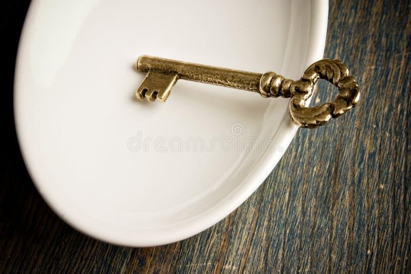 Gold Key in Dish