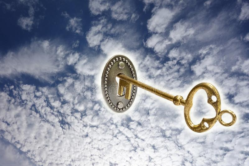 Gold key in the sky stock image