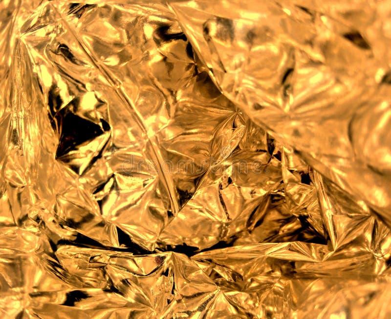 Gold knitterte Folienbeschaffenheit lizenzfreie stockbilder