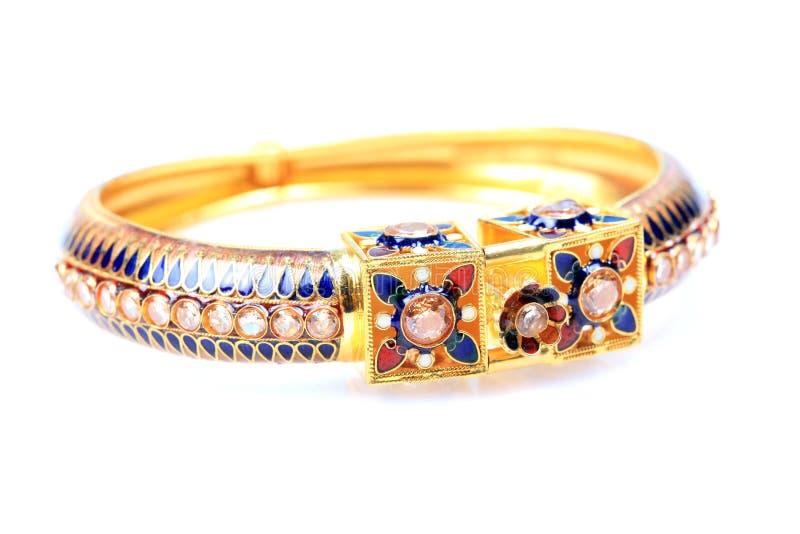 Gold kundan bracelet jewellery. Isolated on white background royalty free stock image