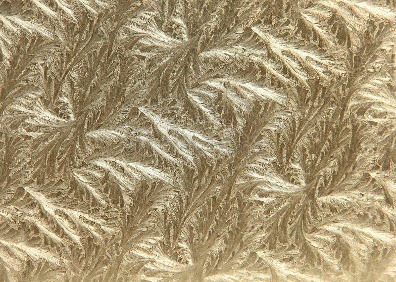 Gold Leaf Metallic Filigree background. Rich Gold leaf metallic filigree brushed background royalty free stock photo