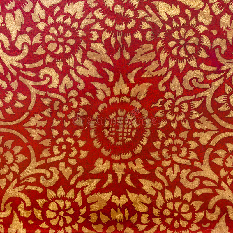 The gold leaf on wood for the background and textures. Thai style pattern on red wall royalty free stock photos