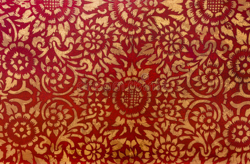 The gold leaf on wood for the background and textures. Thai style pattern on red wall stock photos